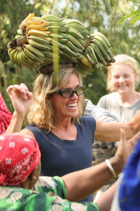 Kat balancing a bunch of bananas
