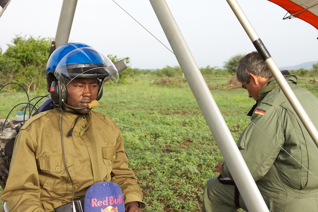 An anti-poaching game scout prepares to fly