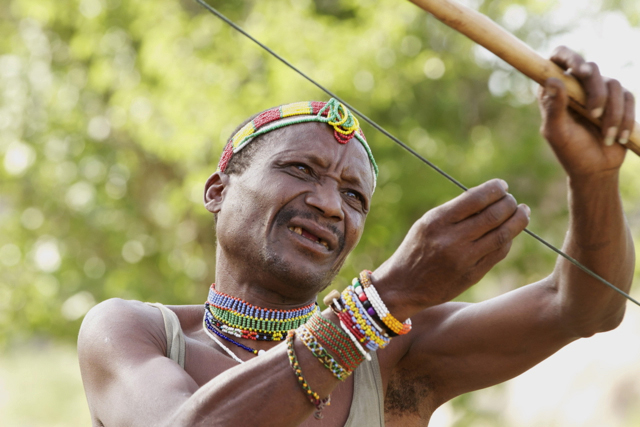 Hadzabe Man testing his bow.